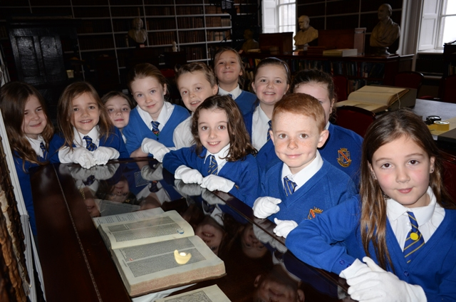 School visit to the Library: Primary school children at one of the display cabinets in the Long Room