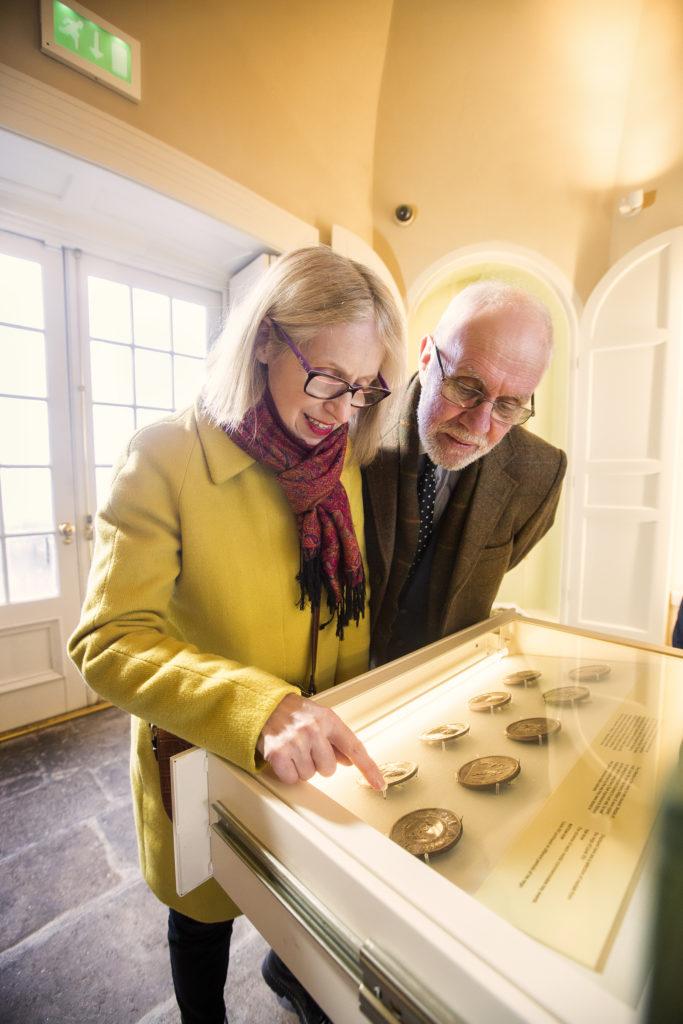 Visitors looking at the medals and coins at No 5 Vicars' Hill