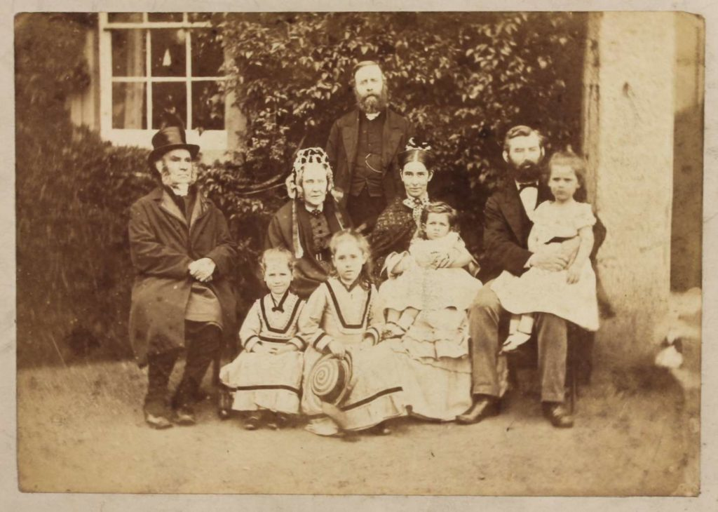 Family photograph of Gregg as a toddler with his parents, grandparents and siblings, ca 1874